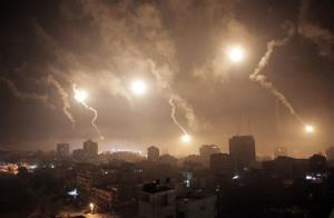 Israeli forces' flares light up the night sky over Gaza City early today.