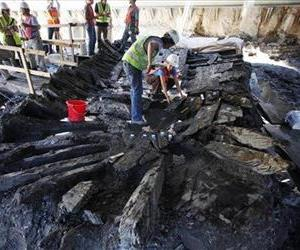 Archeologists begin dismantling the remains of an 18th-century ship at the World Trade Center construction site in 2010 in New York.