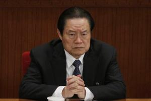 In this photo taken Friday, March 9, 2012, Zhou Yongkang attends a plenary session of the National People's Congress at the Great Hall of the People in Beijing, China.