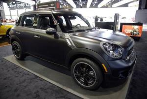 In this Feb. 7, 2014, file photo, a 2014 Mini Cooper S Countryman All4 is on display during the media preview at the Chicago Auto Show at McCormick Place in Chicago.