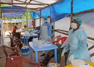 Medical personnel care for Ebola patients on the outskirts of Kenema, Sierra Leone.