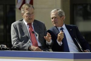George W. Bush talks with his father during the dedication of the George W. Bush Presidential Center, Thursday, April 25, 2013, in Dallas.