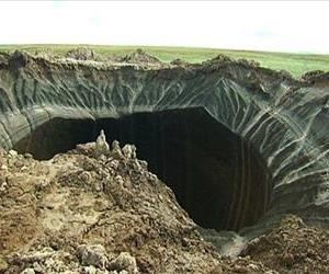 This frame grab made July 16, 2014, shows a crater in the Yamal Peninsula of Siberia.