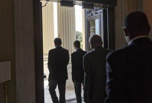 Members of the House of Representatives head for the door on Capitol Hill Thursday.