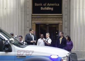 Chicago police stand outside a downtown high-rise office building following yesterday's shooting.