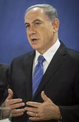 Israeli Prime Minister Benjamin Netanyahu speaks during a cabinet meeting at the defense ministry in Tel Aviv, Israel, Thursday, July 31, 2014.