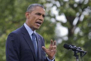 In this July 29, 2014 photo, President Barack Obama speaks on the South Lawn of the White House.