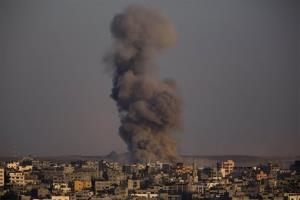 Smoke rises after an Israeli airstrike in Gaza City, Sunday, Aug. 3, 2014.