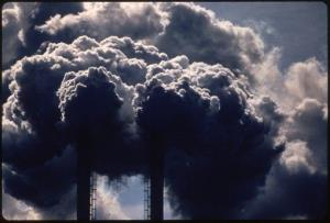 In this July 1972 photo provided by the US National Archives entitled Burning Discarded Automobile Batteries, black clouds billow from smokestacks in Houston, Texas.