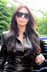 Kim Kardashian arrives at a restaurant in Paris, Thursday, May 22, 2014.