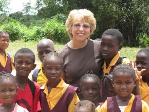 This Oct. 7, 2013 photo shows Nancy Writebol with children in Liberia.