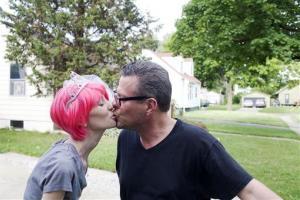 Jennifer Hutcheson, 30, kisses fiance Allen Korth, 49, on July 2.