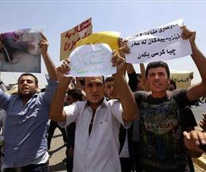 Iraqis from the Yazidi community chant anti-Islamic militants slogans in front of UN headquarters in Irbil, Iraq, on Aug. 4.