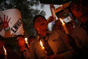 In this file photo, Indian students shout slogans during a vigil on the anniversary of the fatal gang rape of a young woman on a bus in New Delhi, India.