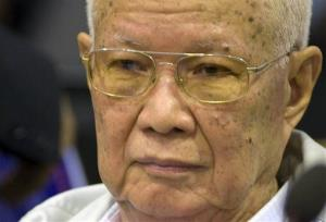 In this photo released by the Extraordinary Chambers in the Courts of Cambodia, Khieu Samphan, the Khmer Rouge's former head of state, sits inside the courtroom.