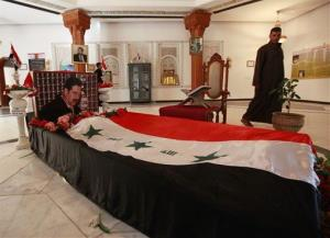 In this Dec. 8, 2011 photo, people visit the tomb of former Iraqi dictator Saddam Hussein.