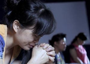 In this photo taken July 16, 2014, church members pray in a private room in a Christian church in the Shuitou township in Wenzhou in eastern China's Zhejiang province.