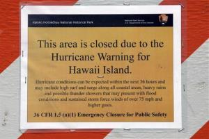 A hurricane warning sign is shown posted on the beach in Kailua, Hawaii yesterday.