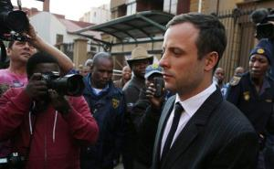 Oscar Pistorius leaves the high court in Pretoria, South Africa, Friday, Aug. 8, 2014. The judge in the murder trial of Oscar Pistorius says she will give a verdict on Sept. 11.