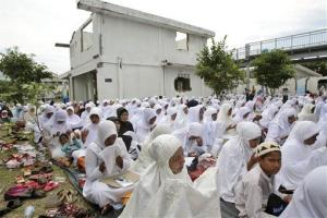 Acehnese women pray for the victims of 2004's Indian Ocean tsunami during a prayer session commemorating the ninth anniversary of the disaster.