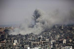 Smoke rises in Gaza City after an Israeli airstrike Saturday.