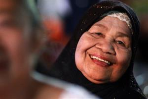 A woman flashes a smile during an event called Return Happiness to Thai People in Bangkok in June.