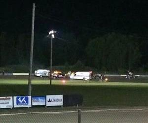 Ambulances at Canandaigua Motorsports Park on Saturday, Aug. 9, 2014 in Canandaigua, N.Y. Authorities are investigating a serious crash that killed one person.