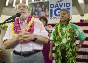 Hawaii Gov. Neil Abercrombie addresses supporters of state Sen. David Ige as he looks on Saturday, Aug. 9, 2014, in Honolulu. Ige defeated Abercrombie in the state's primary.