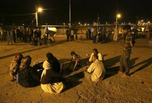 Displaced Iraqis from the Yazidi community settle at the camp of Bajid Kandala at Feeshkhabour town near the Syria-Iraq border, in Iraq, Saturday, Aug. 9, 2014.