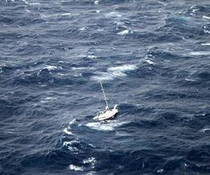 This photo provided by the U.S. Coast Guard shows the 42-foot sailboat Walkabout caught in Hurricane Julio, about 400 miles northeast of Oahu, Hawaii.