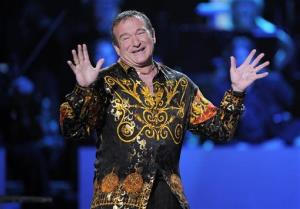 This April 6, 2008, file photo shows actor-comedian Robin Williams speaking on stage at the Idol Gives Back fundraising special of American Idol in Los Angeles.