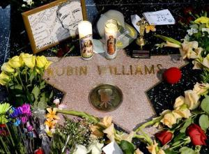 Flowers are placed in memory of actor/comedian Robin Williams on his Walk of Fame star in the Hollywood district of Los Angeles, Monday, Aug. 11, 2014.