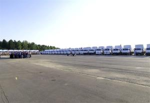 A convoy of trucks reportedly stocked with humanitarian aid is ready to leave Alabino, outside Moscow, Tuesday.