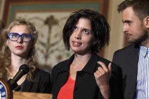 A preview of the show? Nadya Tolokonnikova, center, and Maria Alekhina, left, of the Russian punk band Pussy Riot, join Sen. Ben Cardin, D-Md. at the Capitol.