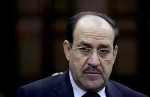 Embattled Iraqi Prime Minister Nouri al-Maliki is in talks to step down, lawmakers say.