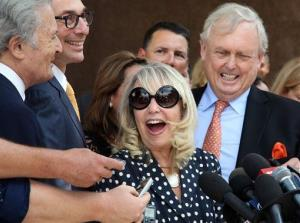 Shelly Sterling, center, talks to reporters after a judge ruled in her favor and against her estranged husband's attempt to block the $2 billion sale last month.