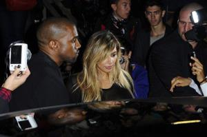 In this Sunday, Sept. 29, 2013, file photo, Kanye West, left, and Kim Kardashian leave after attending Givenchy's ready-to-wear Spring/Summer 2014 fashion collection in Paris.