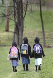 File photo of three Amish girls walking to school in Middlefield, Ohio.