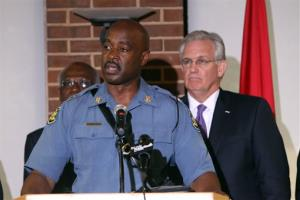 Missouri Gov. Jay Nixon, right, has given police oversight of the Ferguson situation to the Missouri State Highway Patrol under the command of Capt. Ronald S. Johnson, center, a Ferguson native.