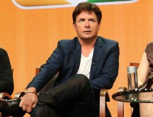 This July 27, 2013 image released by NBC shows actor Michael J. Fox during the NBCUniversal Press Tour in Beverly Hills, Calif. .