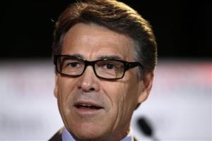 In this Friday, Aug. 8, 2014, file photo, Texas Gov. Rick Perry delivers a speech to nearly 300 in attendance at the 2014 RedState Gathering, in Fort Worth, Texas.