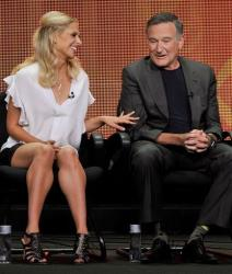Sarah Michelle Gellar, left, and Robin Williams participate in The Crazy Ones panel at the CBS Summer TCA on Monday, July 29, 2013, at the Beverly Hilton hotel in Beverly Hills, Calif.