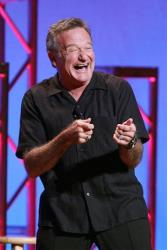"""This Nov. 23, 2009 photo shows Robin Williams performing his stand-up show, """"Weapons of Self Destruction,"""" at Town Hall in New York."""