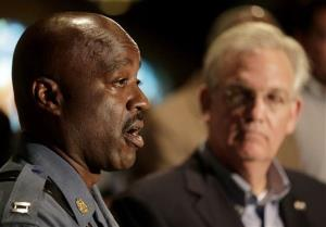 Missouri Gov. Jay Nixon listens as Capt. Ron Johnson, left, talks at a news conference on Saturday, Aug. 16, 2014, in Ferguson, Mo.