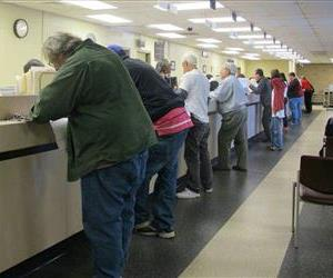 Motorists visit a Department of Motor Vehicles office in this file photo.