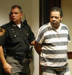 In this Sept. 30, 2008, photo, Kenneth Douglas, right, is led into court before sentencing in Cincinnati, Ohio.