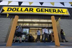 In this Sept. 25, 2013, file photo, customers exit a Dollar General in San Antonio. There's now a bidding war for Family Dollar, with Dollar General offering about $9.7 billion.