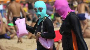 Two women wearing 'facekinis.'