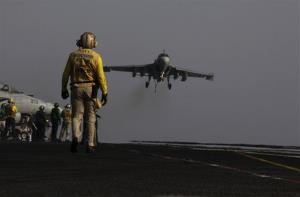 An F/A-18C Hornet coming from Iraq lands on the flight deck of the US Navy aircraft carrier USS George H.W. Bush on Sunday, Aug. 10, 2014 in the Persian Gulf.