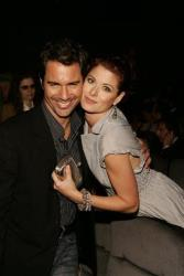 Debra Messing poses with her old co-star from the television series Will and Grace, Eric McCormack, during the premiere party for Messing's series The Starter Wife.